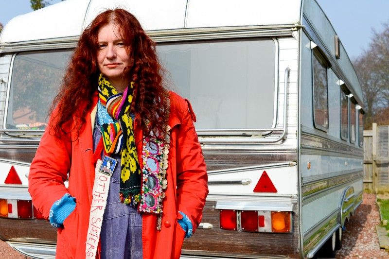 Portrait of Delaine Le Bas Outside Caravan by Amelia Shepherd